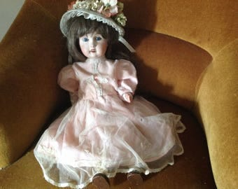 Authentic early 20s iecle porcelain doll