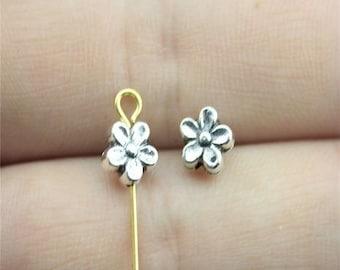 "25 flower shaped ""pucks"" 7mm antique silver metal beads"
