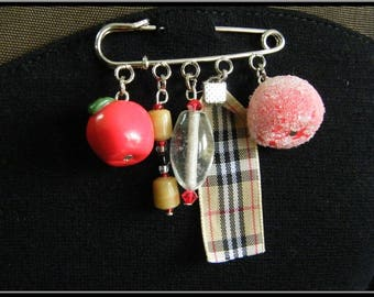 Brooch charms polymer clay and beads.