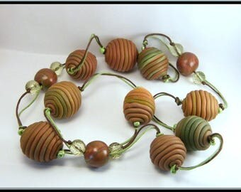 Necklace brown/green spaghetti polymer clay beads.