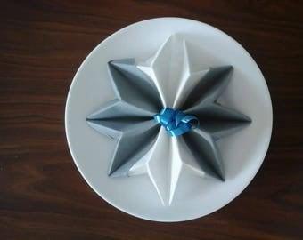 Grey and White Snowflake shaped napkin folding