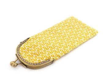 Glasses case in yellow print fabric with clasp