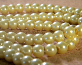 150 iridescent 6 mm PE 213 - champagne - Pearl glass beads