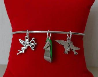 Bangle with silver metal charms