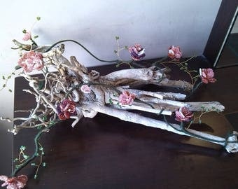 Flower arrangement. Rose. Braid of pink beads in root driftwood. Gifts