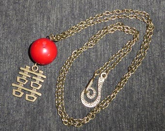 Red coral necklace and brass, Chinese symbol