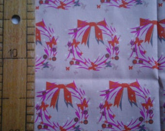 Printed fabric encircled on a pink background