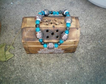 blue glass bead bracelet turquoise and gray and silver charms