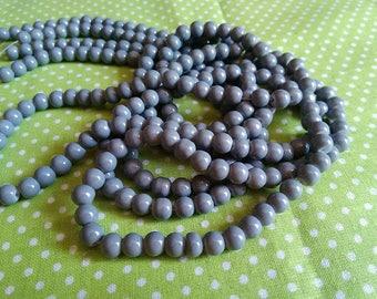 6 mm / 25 6 mm grey glass beads