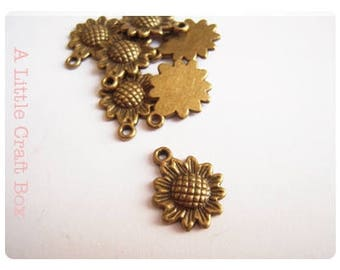 10 sunflower charms - bronze color