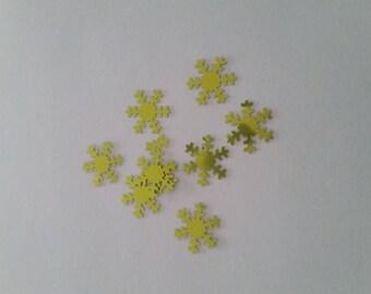 Green snowflake confetti