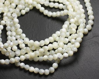Wire 39cm 65pc env - Pearl White iridescent balls 6 mm