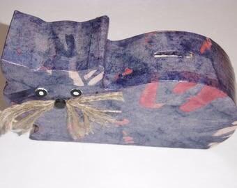 The scroll saw-cut wooden cat piggy bank