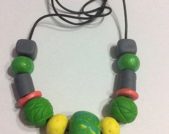 Multi coloured polymer clay beaded necklace.