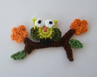 little green OWL sitting on a flowering branch anise - applique crochet