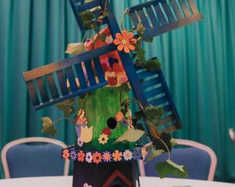 large, brightly coloured wooden windmill