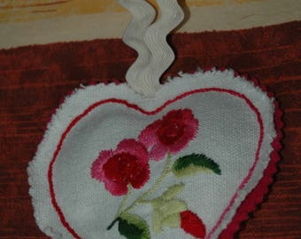 Pink embroidered heart cushion