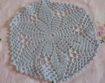 pale blue round doily