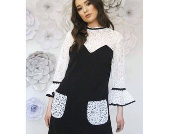 Mini dress with lace panels, flare sleeves and lace pockets