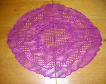 oval doily in purple color