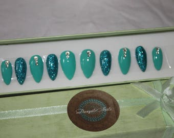 turquoise and blue glitter stiletto false nails