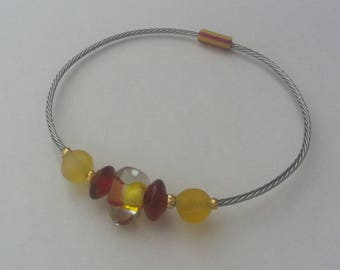 On steel wire, red and yellow glass pearl bracelet