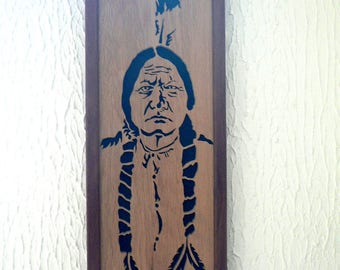 Portrait framed in woodcut of the sioux Chief Sitting bull