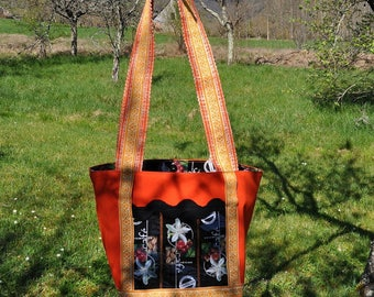 large tote bag slung in canvas and recycled materials