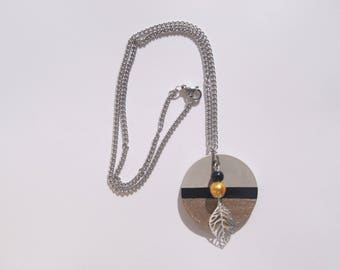 round concrete black and gold necklace