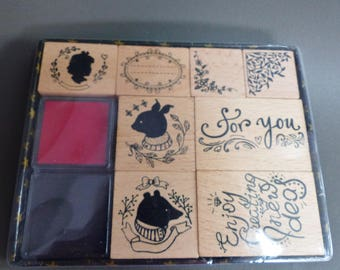 box of 8 stamps in red and black wood and 2 inks pet quotes here