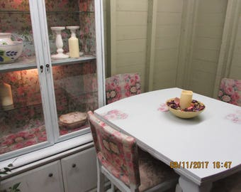 Dining table with four chairs and dresser