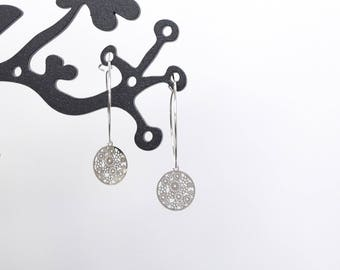 Earrings rings and silver print