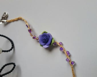 The bracelet holder personalized with a purple fimo flower