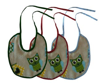 Three handmade bibs with ghufetti and log cabins