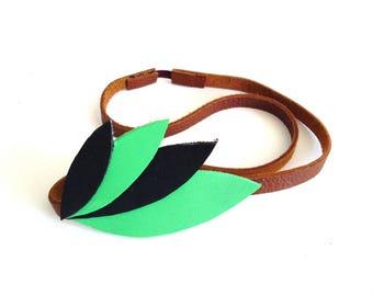 * Headband green feather leather *.