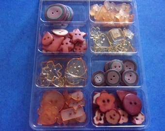 Set of 108 buttons of different shapes and sizes, color brown/orange/yellow