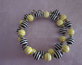 Double bracelet black and white and yellow and white striped acrylic beads
