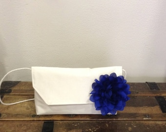 Royal blue flower brooch and off white silk wedding clutch