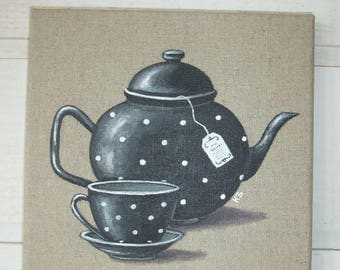 Painting painting black teapot with polka dots