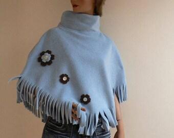 Material poncho sky blue color fleece
