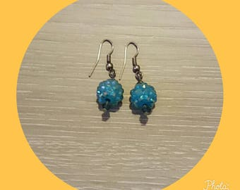 earring with a blue bead