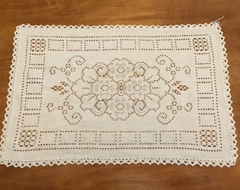 Cut and crocheted dresser doily