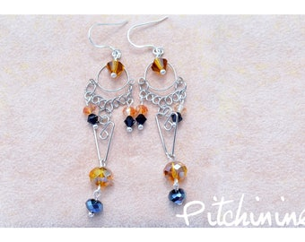 original work of metal and the Swarovski crystals of different sizes and shapes, separated with sterling silver findings