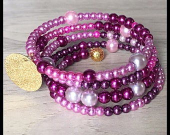 Bracelet 4 row memory glass beads.
