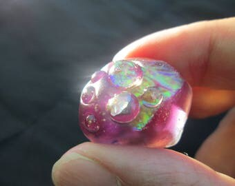 Resin ring of purple with iridescent highlights