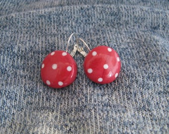 Red earrings with white polka dots