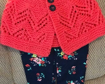 Hand knit voral baby sweater with navy buttons and coordinating flowered pants from Old Navy 9 mos