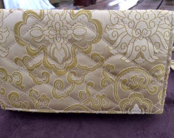Classic quilted golden clutch