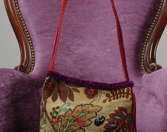 Velvet and colorful and embroidered upholstery fabric handbag