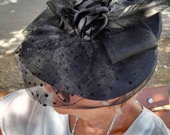 Beautiful fascinator, with black net and lace, feathers and flowers. For any ocassion, fits perfectly. Can be made in colour of your choice.